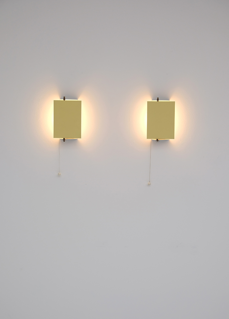 Minimalist wall sconces by Pilastro