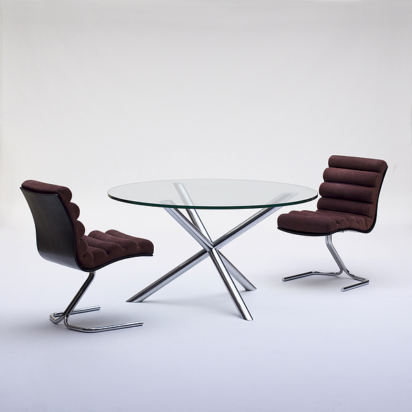 Sculptural dining Table with Four Star Chrome Base