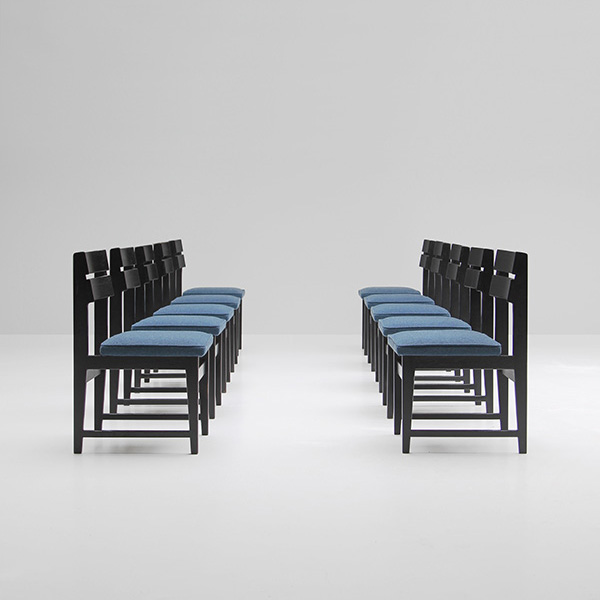 Ten black ebonized dinning chairs