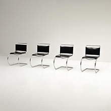 FOUR CHAIRS BY MIES VAN DER ROHE