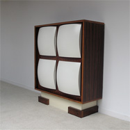 1960s Unusual  rosewood cabinet with space age doors