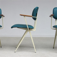 9 industrial 60s design chairs with wooden arm wrest from de Marko