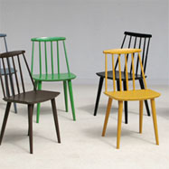8 colorful playful chairs in the manner of Ilmari Tapiovaara