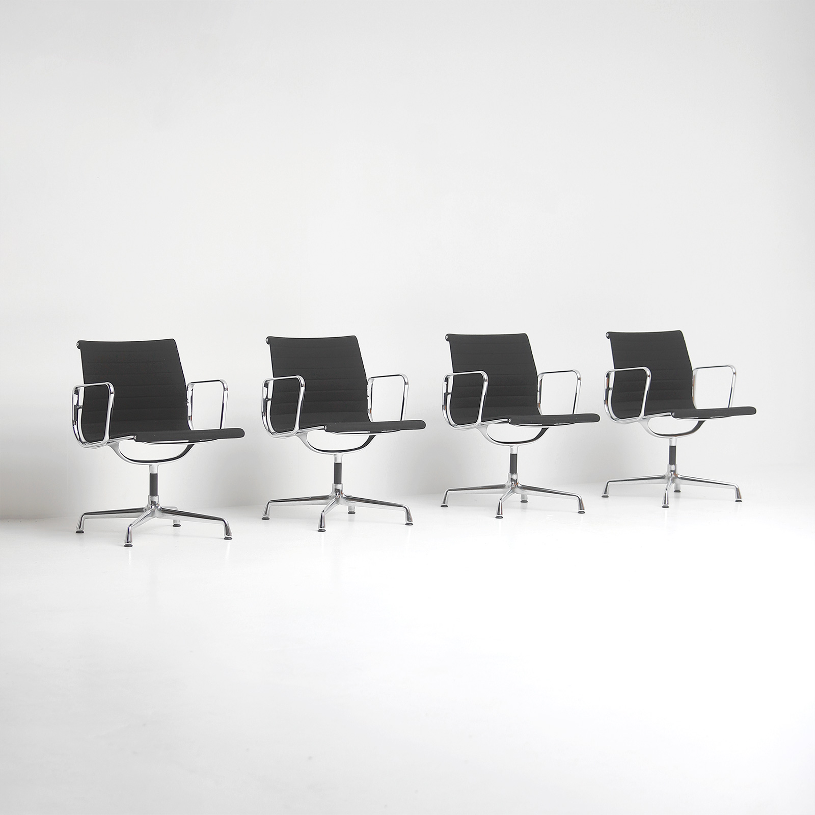 Set of Eames office chairs EA108