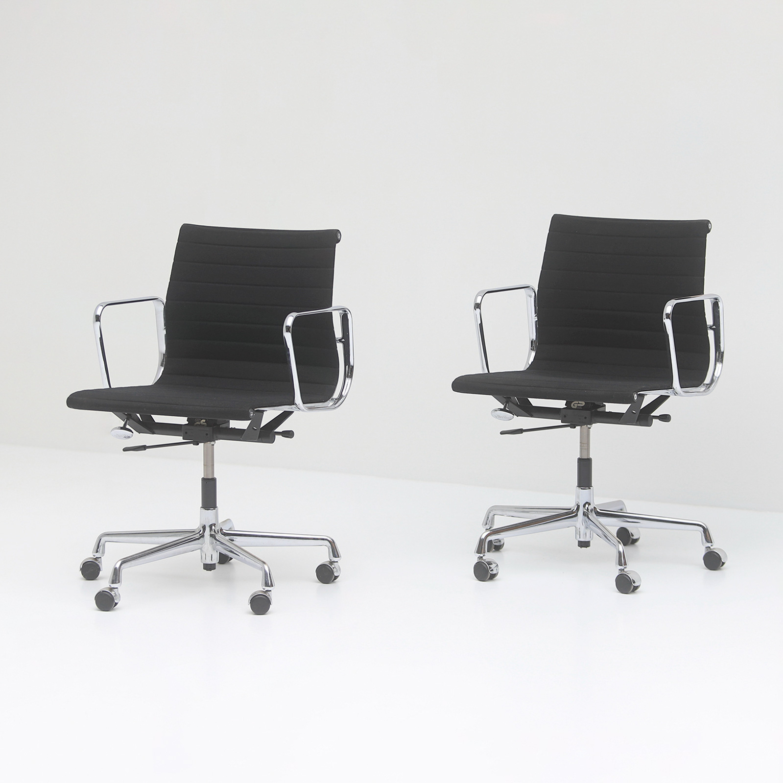 Two Eames office desk chairs ea117
