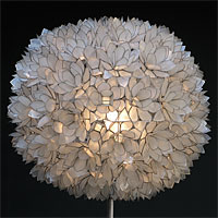 A 70s Flower Ball Floor lamp in Mother-of-Pearl and black Base
