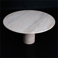 Round travertine pedestal table in the manner of  Angelo Mangiarotti