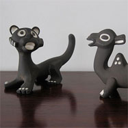 50's Ravelli lion and camel ceramic figures