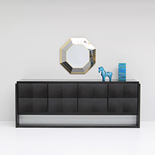 Sculptural credenza with black ebonized body and solid oak doors