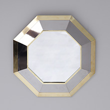 Decorative 1980s brass mirror in a hexagonal form