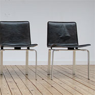 4 black leather Horst Bruning? chairs